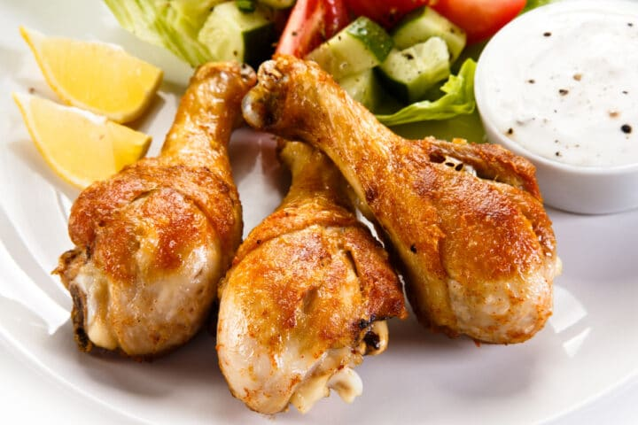 3 air fryer chicken legs with salad and dip