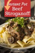 Instant Pot Beef Stroganoff served over wide buttered noodles