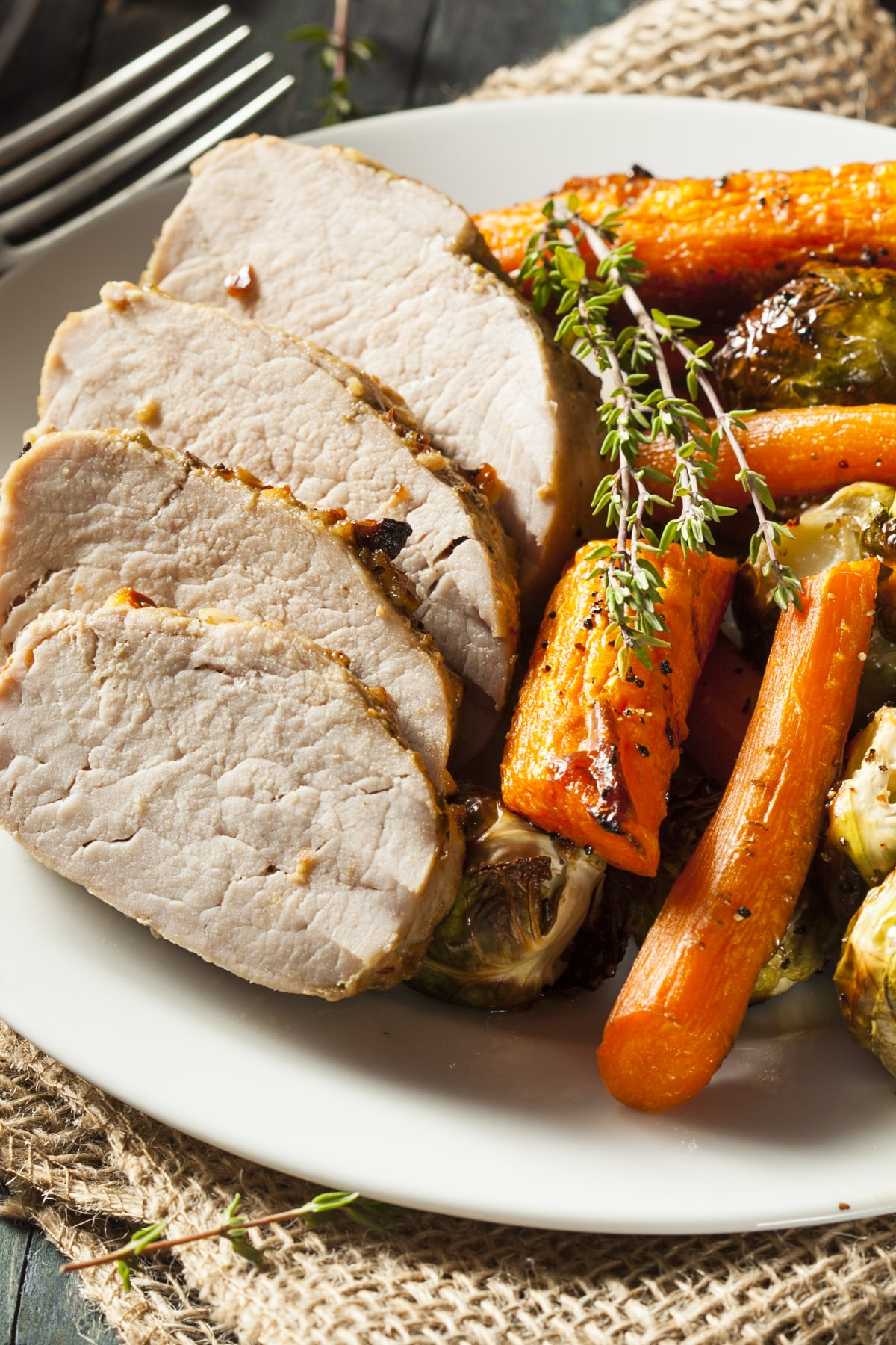 Instant Pot Pork Roast served with carrots and brussels sprouts. An easy, delicious dinner.