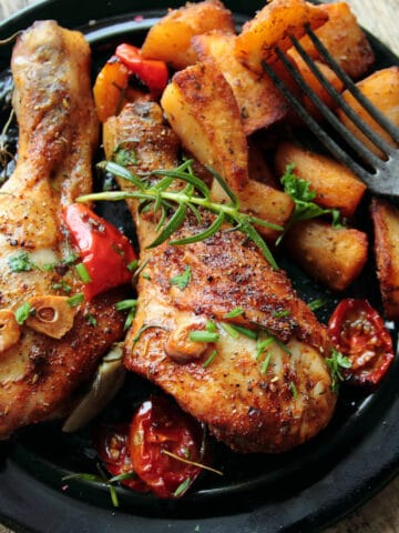 air fryer chicken legs served with crispy potatoes