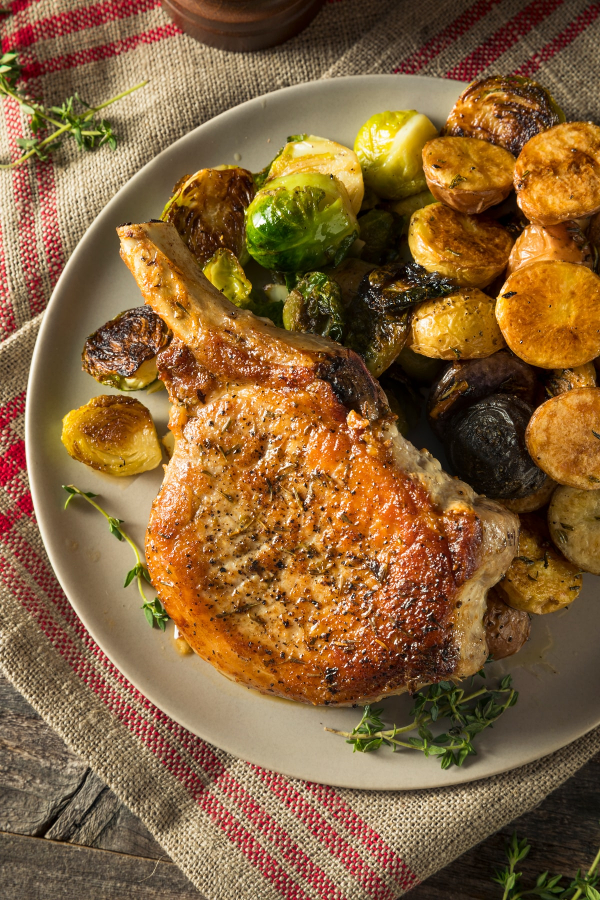 air fryer pork chop with roasted potatoes and brussels sprouts
