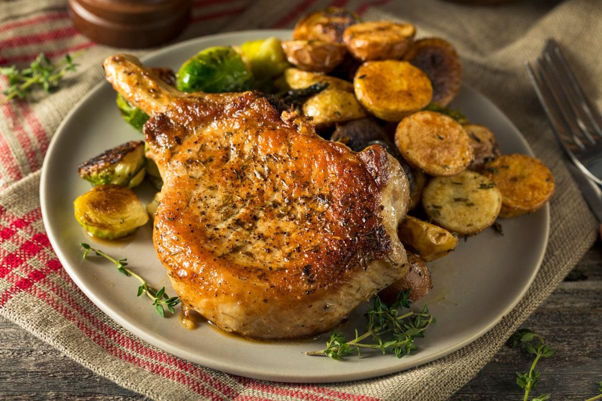 air fryer pork chops with garlic sage rub and potatoes