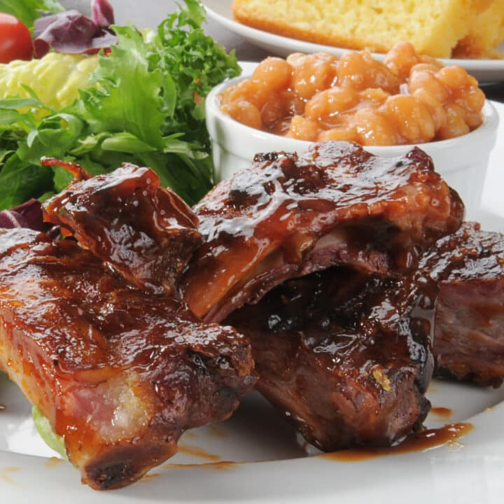 BBQ Ribs in Oven served with cornbread and a salad