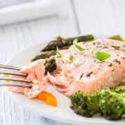 Baked salmon is done when it flakes easily when tested with a fork and the fish is opaque.