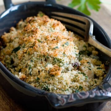baked tilapia in a oval black casserole dish - example of an easy dinner idea