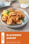 Blackened Shrimp served with a lemon wedge.