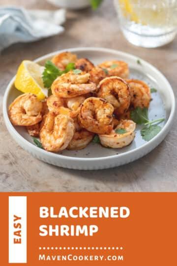 Blackened Shrimp served with a lemon wedge.