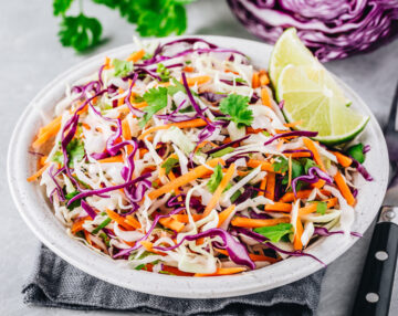 Cabbage Slaw for Tacos with lime in a white bowl