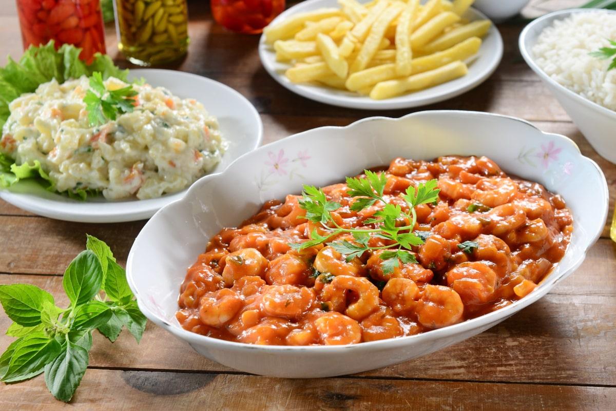 platter of deviled shrimp with sides
