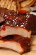 carved bbq ribs bbq sauce closeup