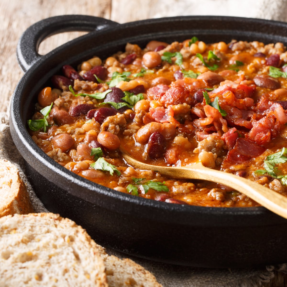 close up view of cast iron dutch oven with frijoles charros