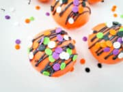 cocoa bombs sprinkled with colorful sprinkles