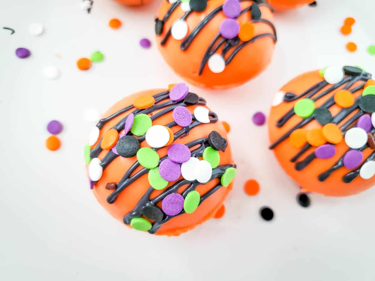 top down view of cocoa bombs sprinkled with colored sprinkles