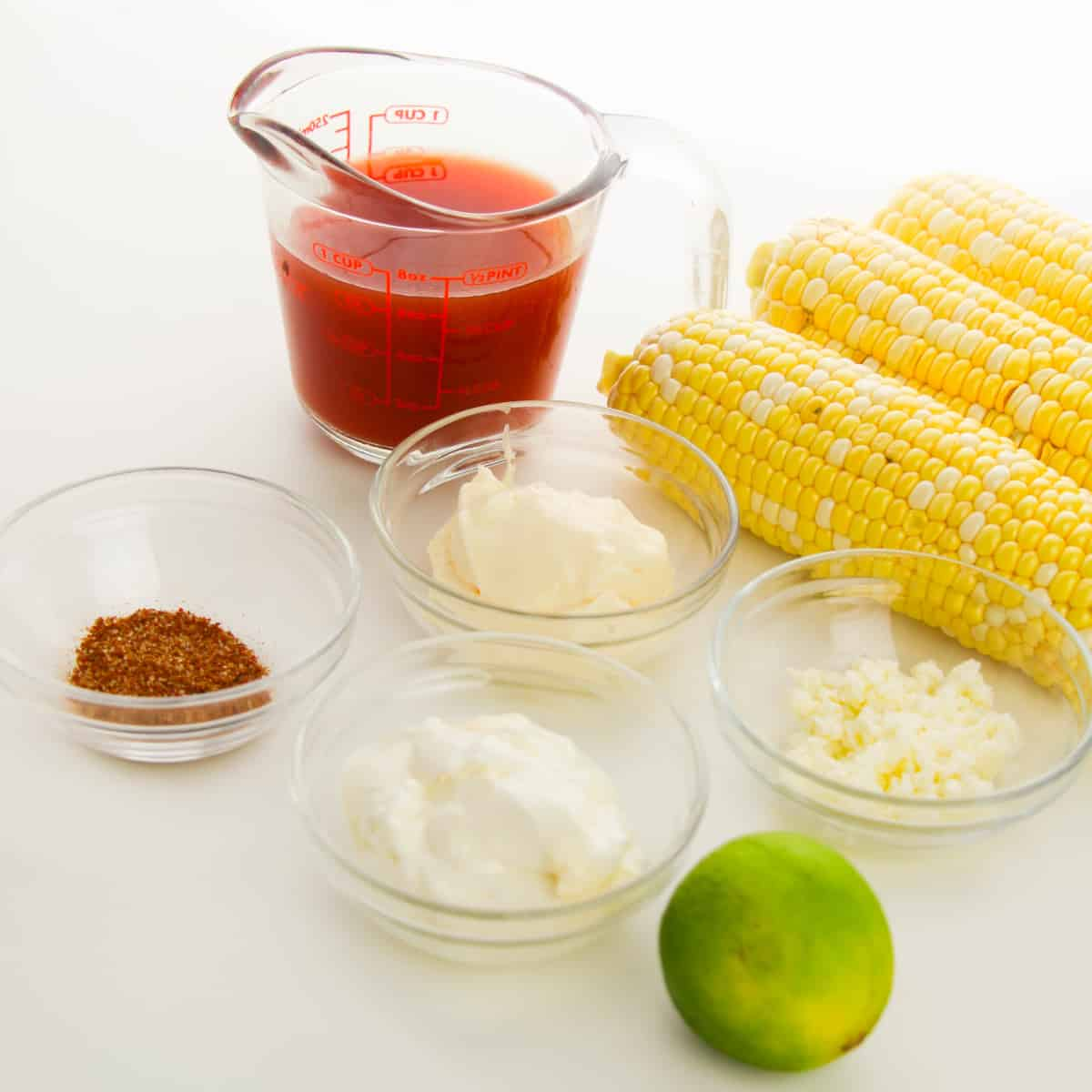 ingredients for corn fries on a white work surface