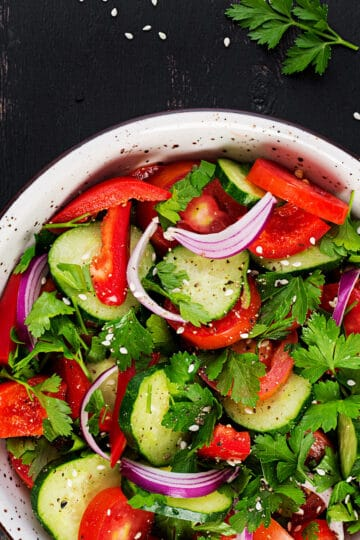 Cucumber Tomato Salad for a side dish or a summer lunch. Perfect served with chicken or pork. #salads #cucumbers #tomatoes #cucumbertomatosalad #cucumbertomato #cucumbersalad #tomatosalad