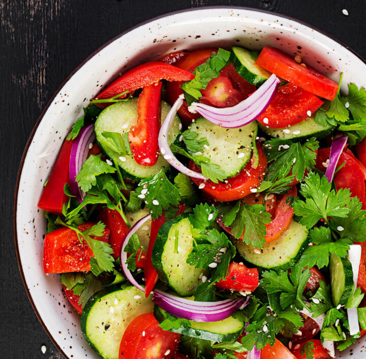 Cucumber Tomato Salad is a wonderful side dish for chicken, pork, or fish. #salads #cucumbers #tomatoes #cucumbertomatosalad #cucumbertomato #cucumbersalad #tomatosalad