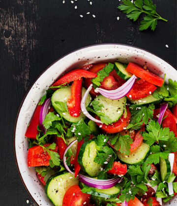 Cucumber Tomato Salad with red onions, a tarragon vinaigrette, sesame seeds, and one of our family favorites.