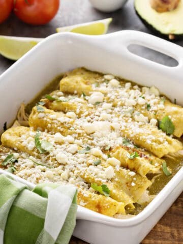 Enchiladas Verdes with Cotija cheese sprinkled on top