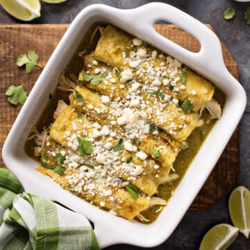 Enchiladas Verdes top view baked in casserole dish sprinkled with Cotija