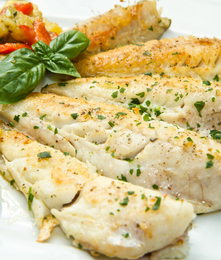 Pan fried cod fillets, seasoned, lightly floured and drizzled with a herb butter sauce.
