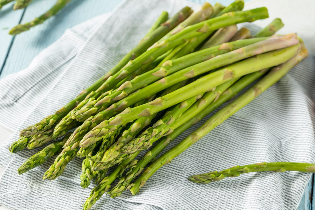 Fresh asparagus laying on a towel ready for the air fryer