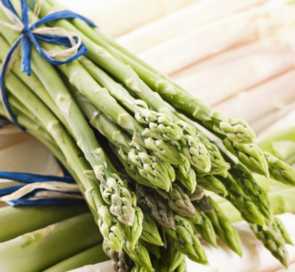 A fresh bunch of asparagus with bright green color and closed tips.