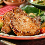 Pan Fried Pork Chops with nicely browned exterior ready to serve.