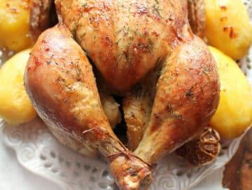 Roast chicken closeup showing tied chicken legs