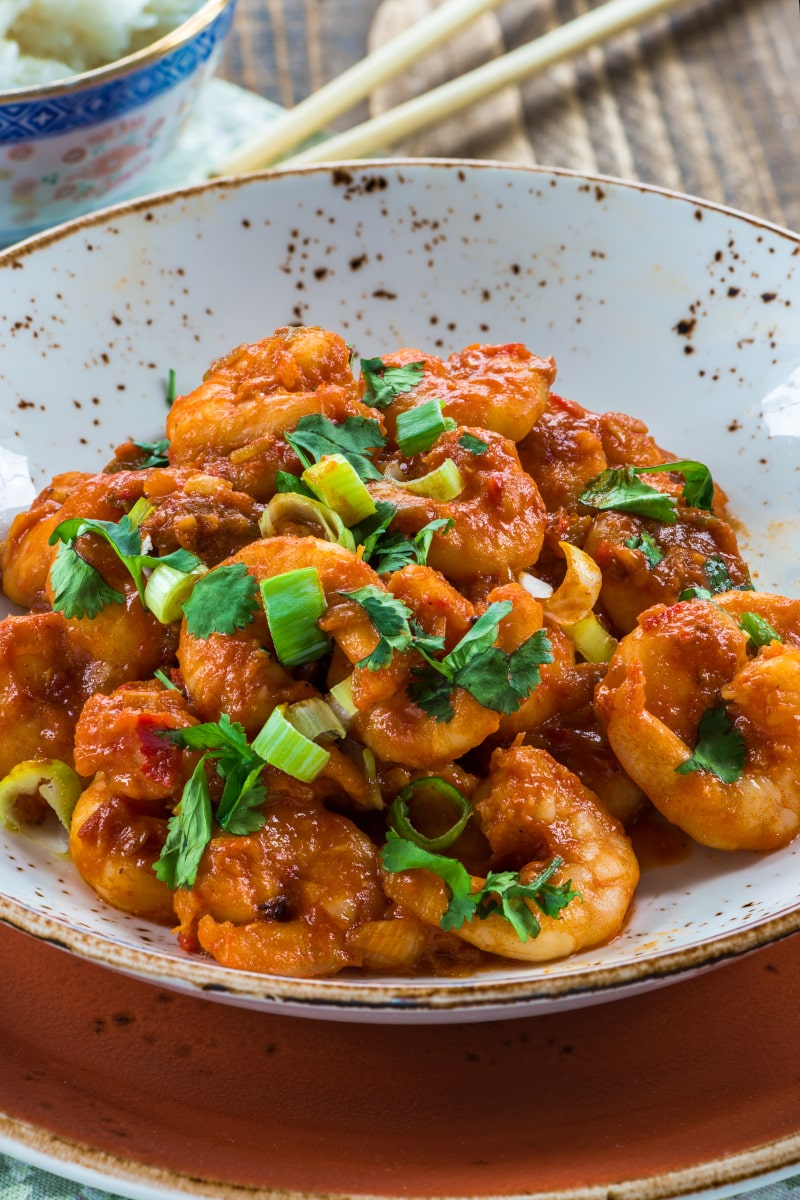 Close-up of spicy shrimp with chopped cilantro and green onions