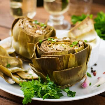 2 Instant Pot Artichokes served with dipping sauce and white wine