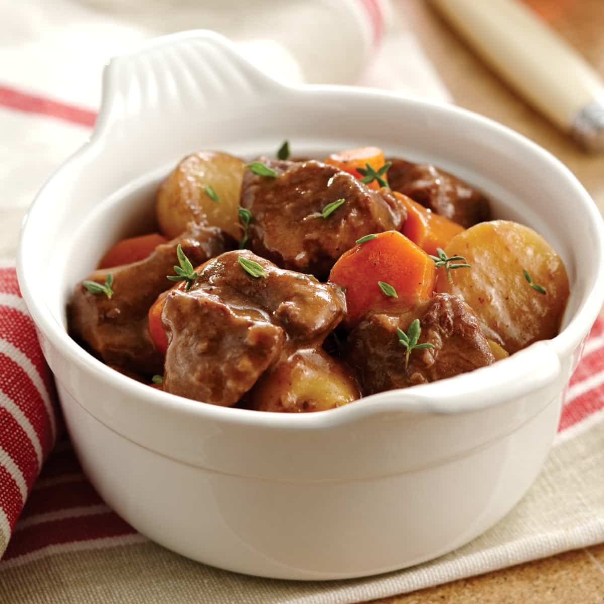 instant pot beef stew in a ceramic bowl