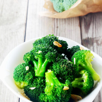 Instant Pot broccoli in a serving bowl. The broccoli retains its nutrients with steaming and the florets stay bright green.