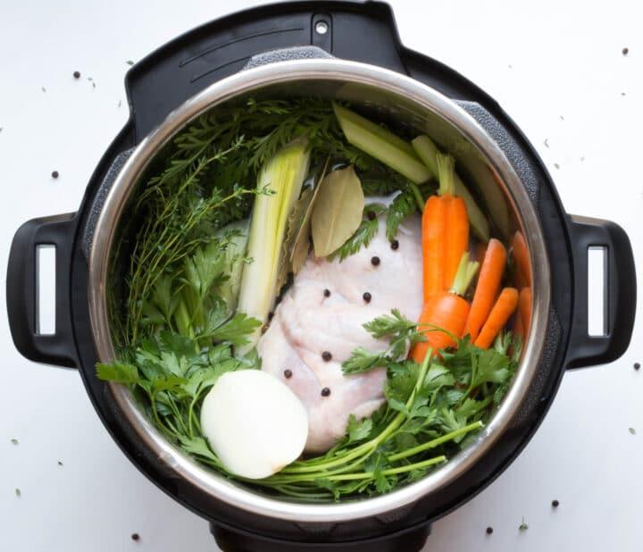 Instant Pot Chicken Stock ingredients in the pressure cooker