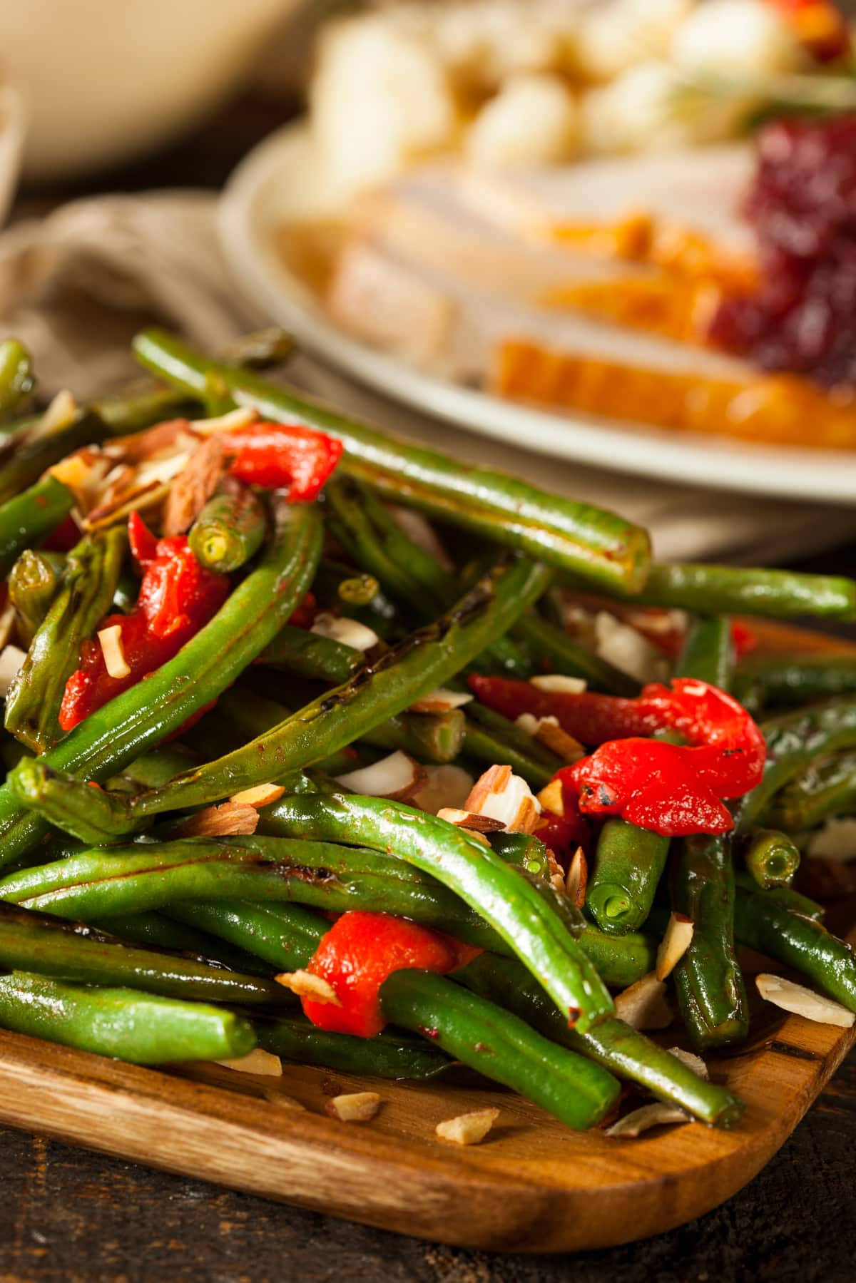 Instant Pot green beans with pimentos, slivered almond and garlic served as a side dish. Instant Pot green beans are an easy Holiday side dish.