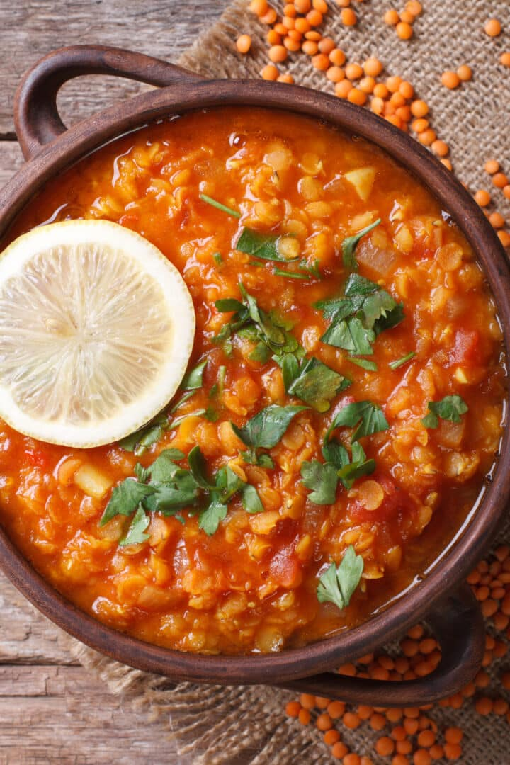 Instant Pot lentils stew top down view with lemon and parsley