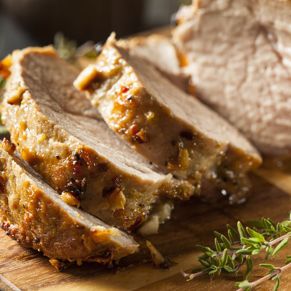 Carved Instant Pot Pork Roast. Juicy, tender slice with herbs and spices on the edges.