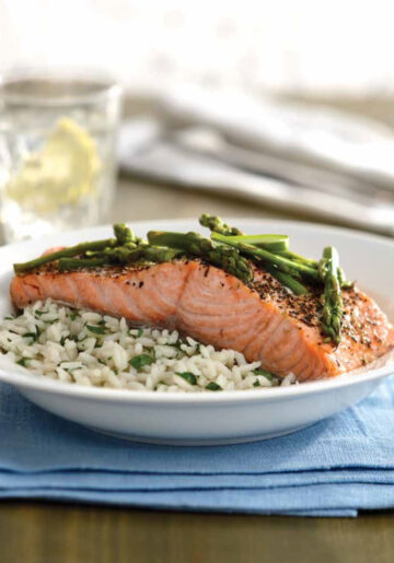 Instant Pot Salmon with Herbs, Lemon-Butter sauce, and Asparagus served on top of Instant Pot Rice Pilaf