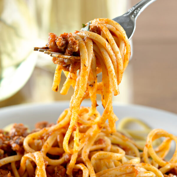 Instant Pot Spaghetti with meat sauce twirled on s fork.