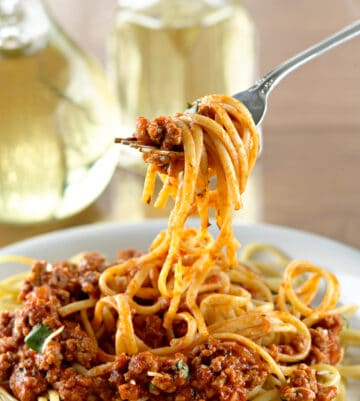 Instant Pot Spaghetti with perfect al dente noodles on fork with meat sauce