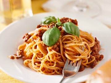 Instant Pot Spaghetti in a bowl with tomato sauce, meat and basil