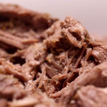 juicy tender mounds of pulled pork shoulder ready for tortillas