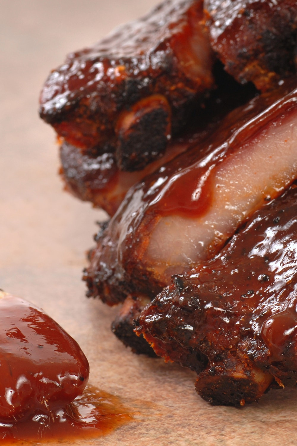 Kansas City Barbecue Sauce dripping over tender bbq ribs