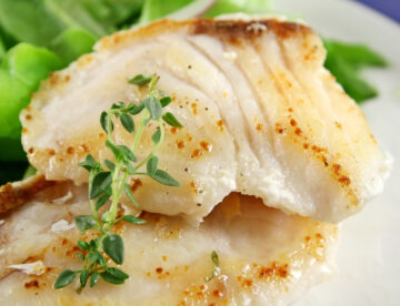 Flaky pan fried cod with herb butter sauce. The cod comes out lightly crispy on the outside and moist and flaky on the inside.