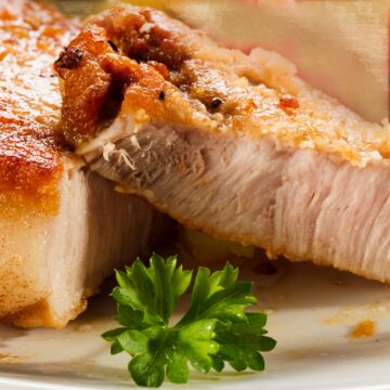 Perfectly Cooked Pork Chop showing a browned exterior and a hint of pink in the center.