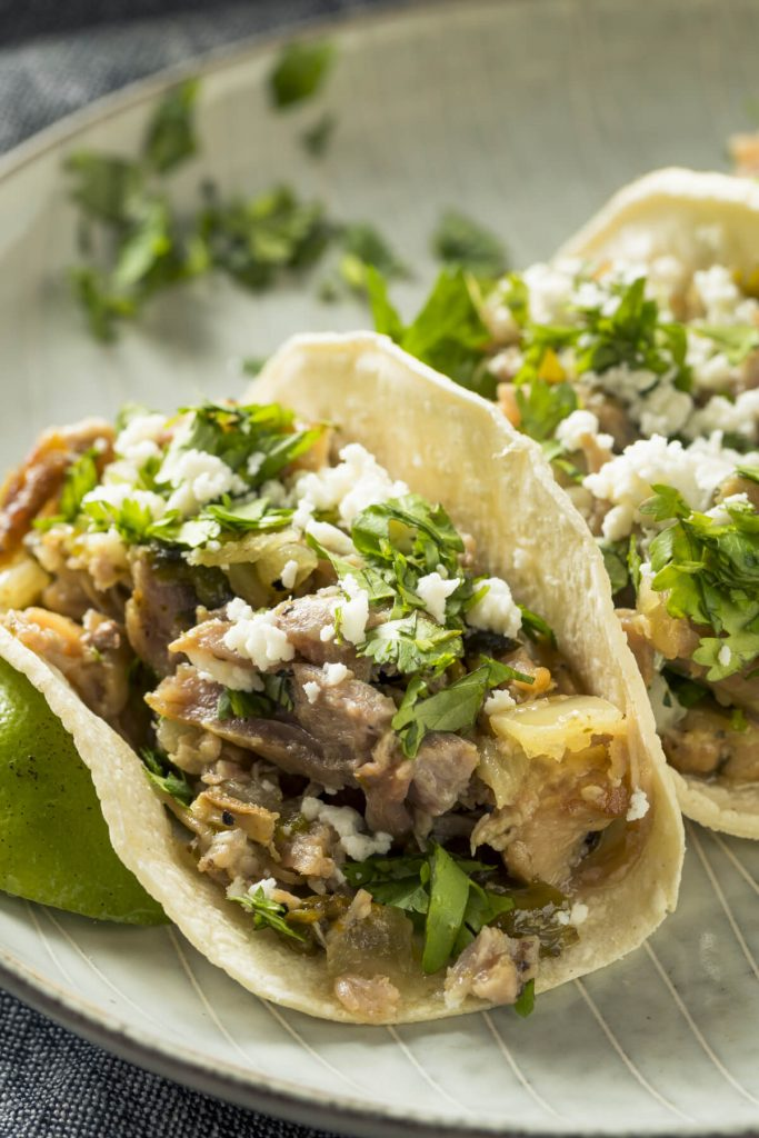 Pork Carnitas sprinkled with cotija and cilantro. The pork is cooked in the Instant Pot for juicy, tender and delicious results. We love our Mexican dishes.