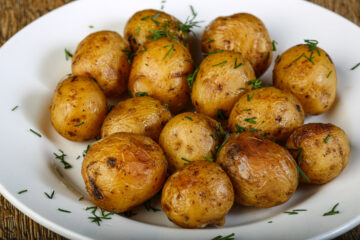 Roasted Baby Potatoes in a white serving Bowl