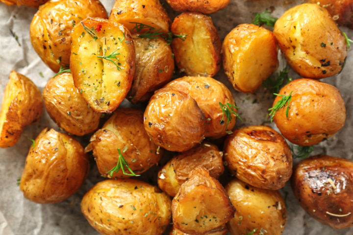 Roast Baby Potatoes roasted on a sheetpan spaced for roasting.