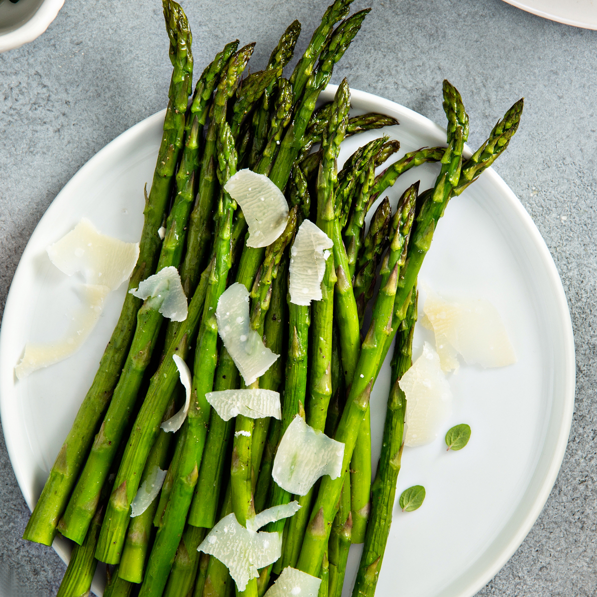 Oven roasted asparagus with shaved parmesan makes the perfect side dish for fish, poultry, meat or pork.