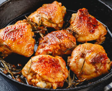 Roasted Chicken Thighs closeup with crispy skin