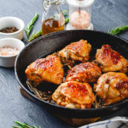Roasted Chicken Thighs in pan with seasonings